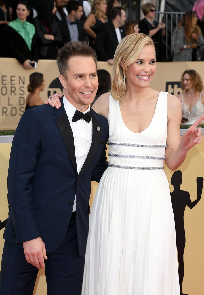 "Sam Rockwell and long-time love Leslie Bibb arrived hand-in-hand at the Screen Actors Guild Awards on Sunday, giving fans an inside view at what a 10-year relationship looks like. The couple met coincidentally in a hotel lobby in 2007, and while interviewing the sweet duo on the red carpet, Giuliana Rancic asked Sam and Leslie what everyone else was thinking: what is the key to their relationship? (Read: how the hell do they do it?!) Sam, being the gentleman he is, said ""communication,"" while Leslie cut right to the chase and said ""good sex."" They also added ""a healthy sense of humor"" is key, which they made very clear throughout the entire interview. The Three Billboards Outside Ebbing, Missouri actor is nominated for outstanding performance by a male actor in a supporting role and outstanding performance by a cast in a motion picture. Read on to see Sam and Leslie's sweet photos from the red carpet."