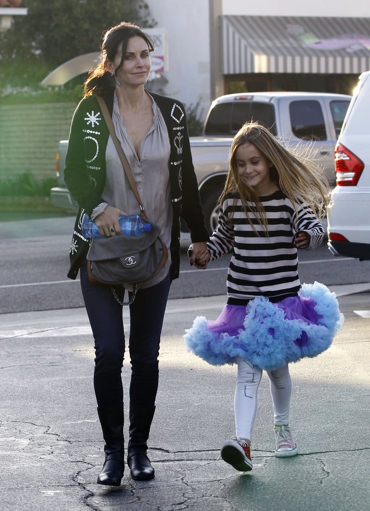 Courteney Cox and her daughter, Coco, spent their Halloween grabbing lunch and doing a little shopping in their Brentwood neighborhood. Coco sported a tutu and white tights as her costume, while Courteney opted for jeans and a Chanel bag. The actress is gearing up for the return of her comedy in 2013.  Next season, Cougar Town is moving to TBS, and new episodes of the sitcom begin airing on Jan. 8.  Courteney and Coco were one of many sets of famous parents and kids to mark the holiday yesterday — check out our roundup of all the celebrities and their kids in costume!