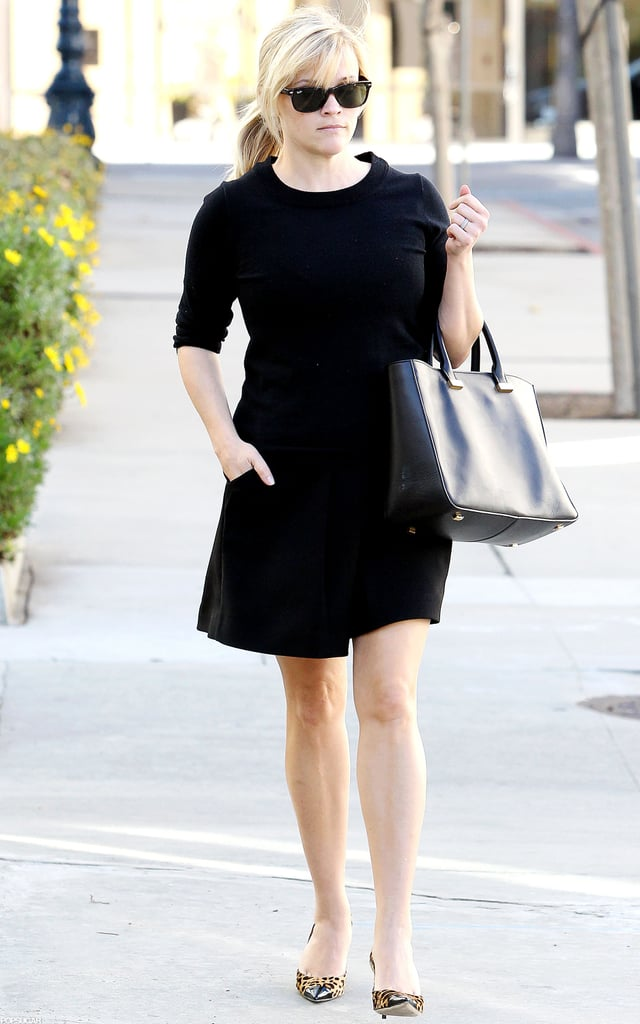 Reese Witherspoon tucked one hand in her pocket.