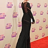 Miley Cyrus showed off her sexy black gown at the VMAs.