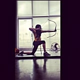 Troian stays fit by trying out unique exercise routines. Archery can give the upper body and arms a great workout.