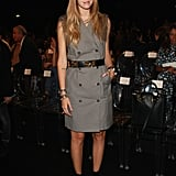 Chiara Ferragni belted her vest dress — only adding a slick black ankle boot — for her appearance at Alberta Ferretti.