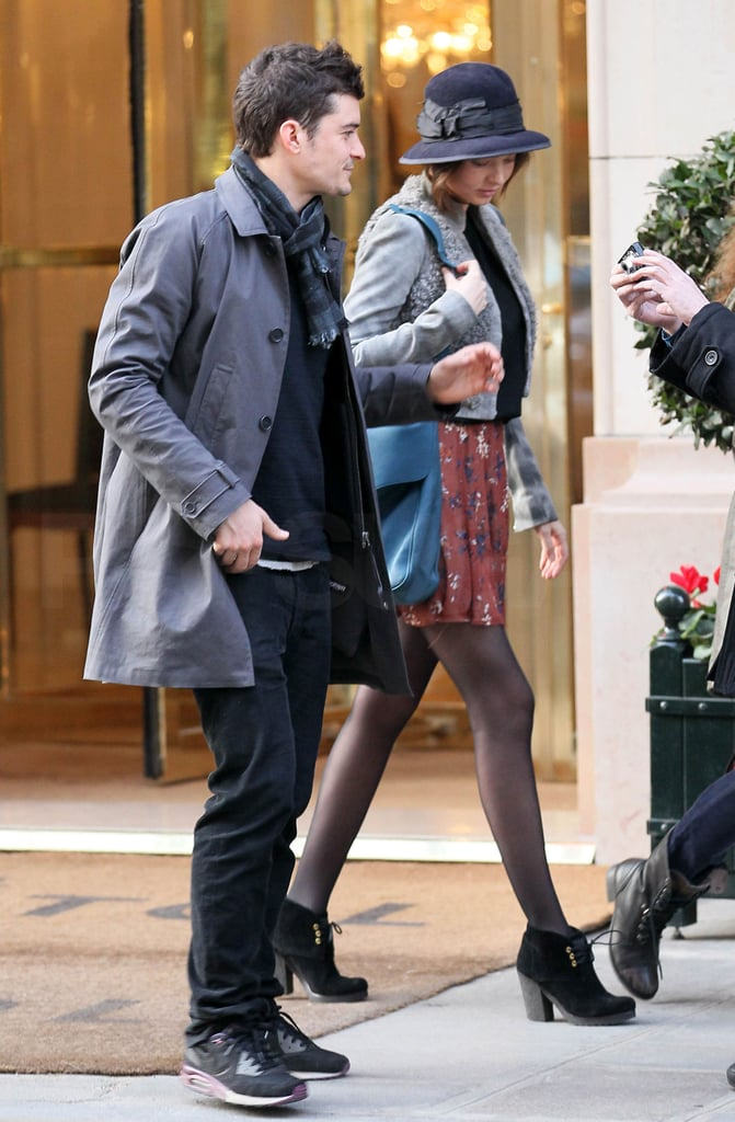 """Orlando Bloom and Miranda Kerr arrived in Paris this morning with their 2-month-old son, Flynn, and they didn't waste much time before heading out for an afternoon appointment at the Balenciaga offices. Her arrival in France coincides with the start of the city's Fall Fashion Week, and many speculate that she will walk in her friend Nicolas Ghesquière's show tomorrow. She addressed a possibility of a fun project in the works on Twitter yesterday as well. She wrote, """"Some exciting things happening guys. I'll be back in touch soon."""""""