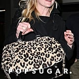 Kirsten Dunst carried a leopard bag.