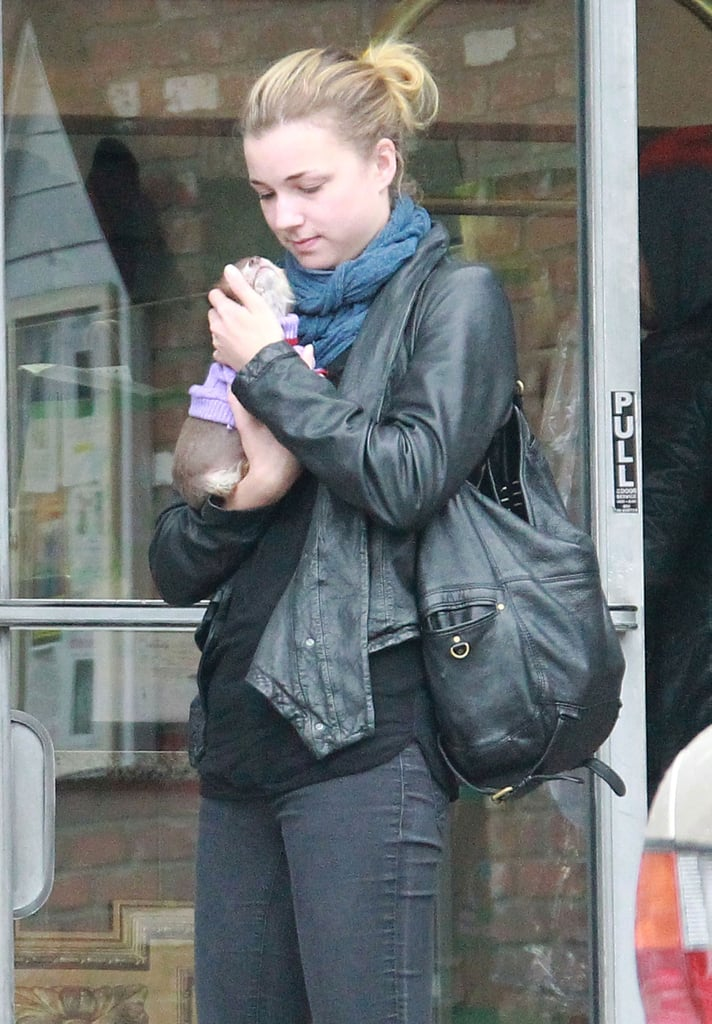 Emily VanCamp with a dog in LA.