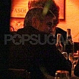 George Clooney out to dinner with a lady friend.