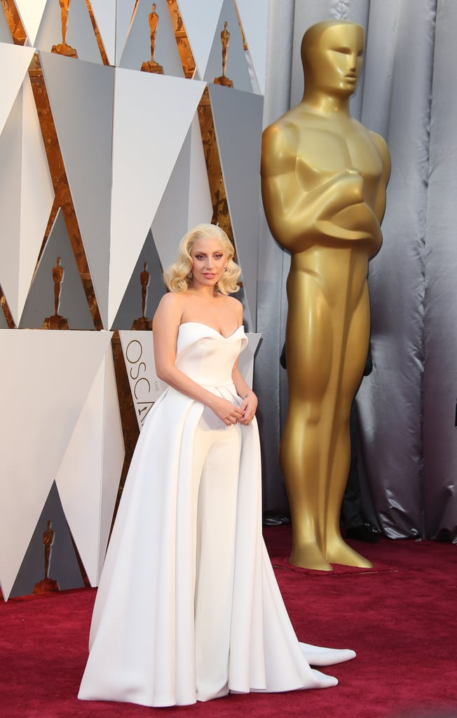 The forthcoming 2019 Academy Awards will be huge for Lady Gaga, who's nominated in two categories, but it certainly won't mark her first time attending the award show. The singer and actress previously attended the Oscars for three consecutive years in 2014, 2015, and 2016 and delivered stirring performance at the latter two. Along the way, she also wore some incredible outfits. While the Versace gowns she wore at her first Oscars appearance was classically glamorous, Gaga went on to make headlines with the pair of red leather Azzedine Alaïa gloves she wore in 2015. The following year, she wore three white jumpsuits by Brandon Maxwell throughout the evening, exuding strength and confidence.  Given the elegant gowns she's already worn to the Golden Globes, Critics' Choice Awards, and SAG Awards, we're probably in store for something really special. Ahead, see all of Gaga's Oscars dresses throughout the years.      Related:                                                                                                           Trust Me, Lady Gaga's Most Memorable Red Carpet Looks Deserve Your Undivided Attention