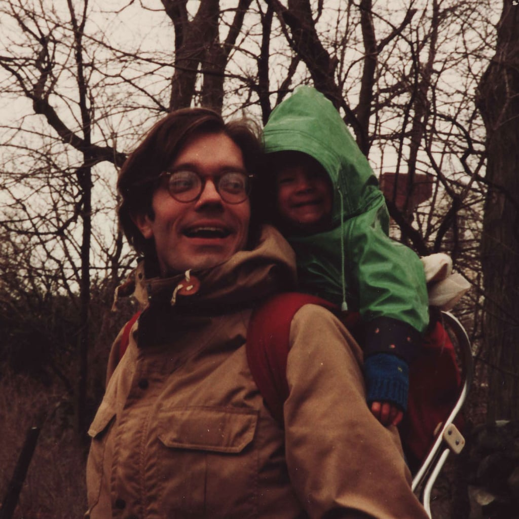 """My dad spent long hours at the hospital Monday-Friday wearing suits, but when weekends and vacations rolled around he was all about rugged gear in the great outdoors. Some of my earliest memories are riding in this backpack during hikes around Massachusetts and Maine. As for his look? I'm pretty sure you can get those '80s glasses at Warby Parker today."" — Molly Goodson, vice president of content"