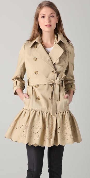 Trust Valentino to perfect the sweetest take on the trench with laser-cut detailing and a fit-and-flare hemline.  Red Valentino Ruffle Trench Coat with Eyelet Trim ($895)