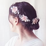 For a romantic feel, this set of three hairpins  ($55) will do the job. The pale-pink blossoms and delicate preserved baby's breath make for one dreamy combination.