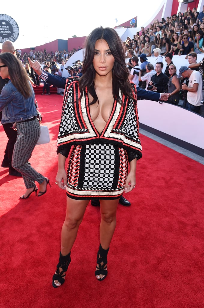 Kim wore this beaded dress and woven caged heels to the MTV VMAs in 2014.