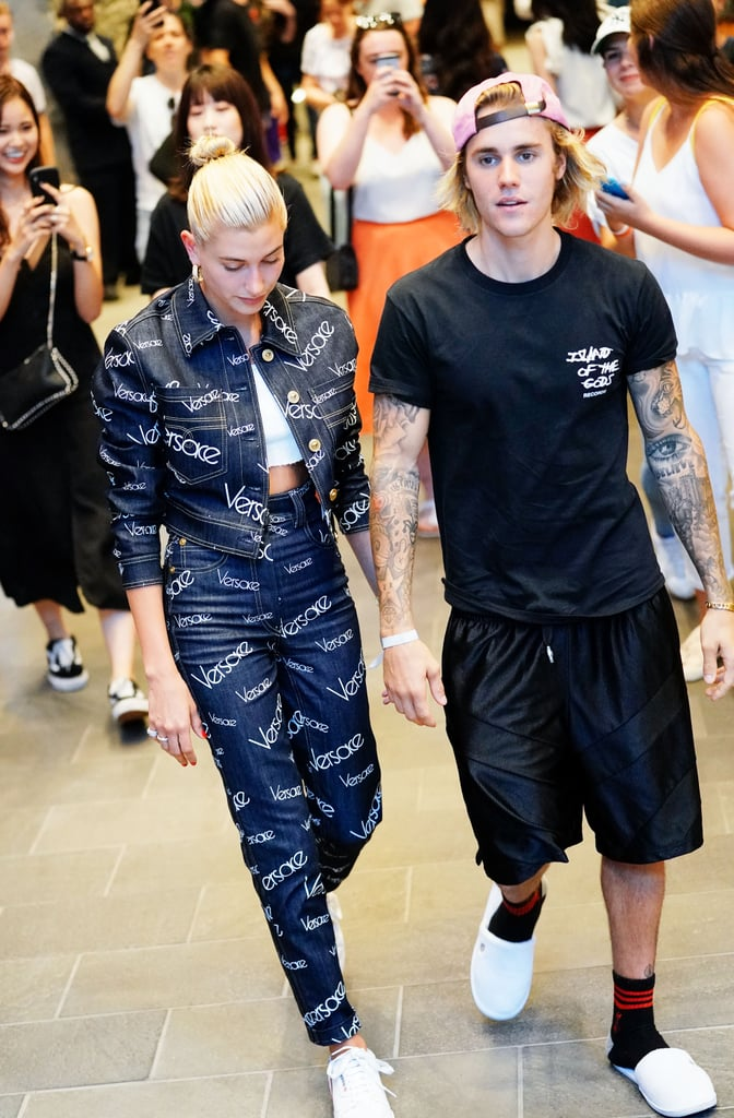 Hailey wore a head-to-toe denim Versace look when she stepped out with Justin Bieber in New York in July. She finished the outfit with white Adidas sneakers and her trusty Jennifer Fisher hoops.