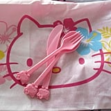 Passengers aboard the jet can rest their heads on pink cushion covers and eat their Hello Kitty meals with themed utensils.