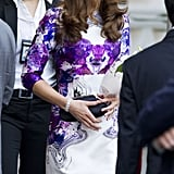 The Duchess teamed her Rorschach dress with a black clutch.