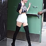 After her June 2013 Good Morning America appearance, Miley waved to fans in a cropped sequin top; fuzzy hot pants; and suede, over-the-knee Louboutin boots.
