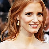 Jessica Chastain kept her style soft and romantic and added a pair of Harry Winston earrings to her look.