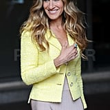 Sarah Jessica Parker wears a yellow jacket.