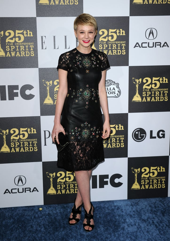 Carey proved her street-cred in an edgy leather Christopher Kane sheath at the Independent Spirt Awards in LA. She accessorised her intricate creation, adorned with embellished jewels and lace trim, with cutout Rupert Sanderson sandals.