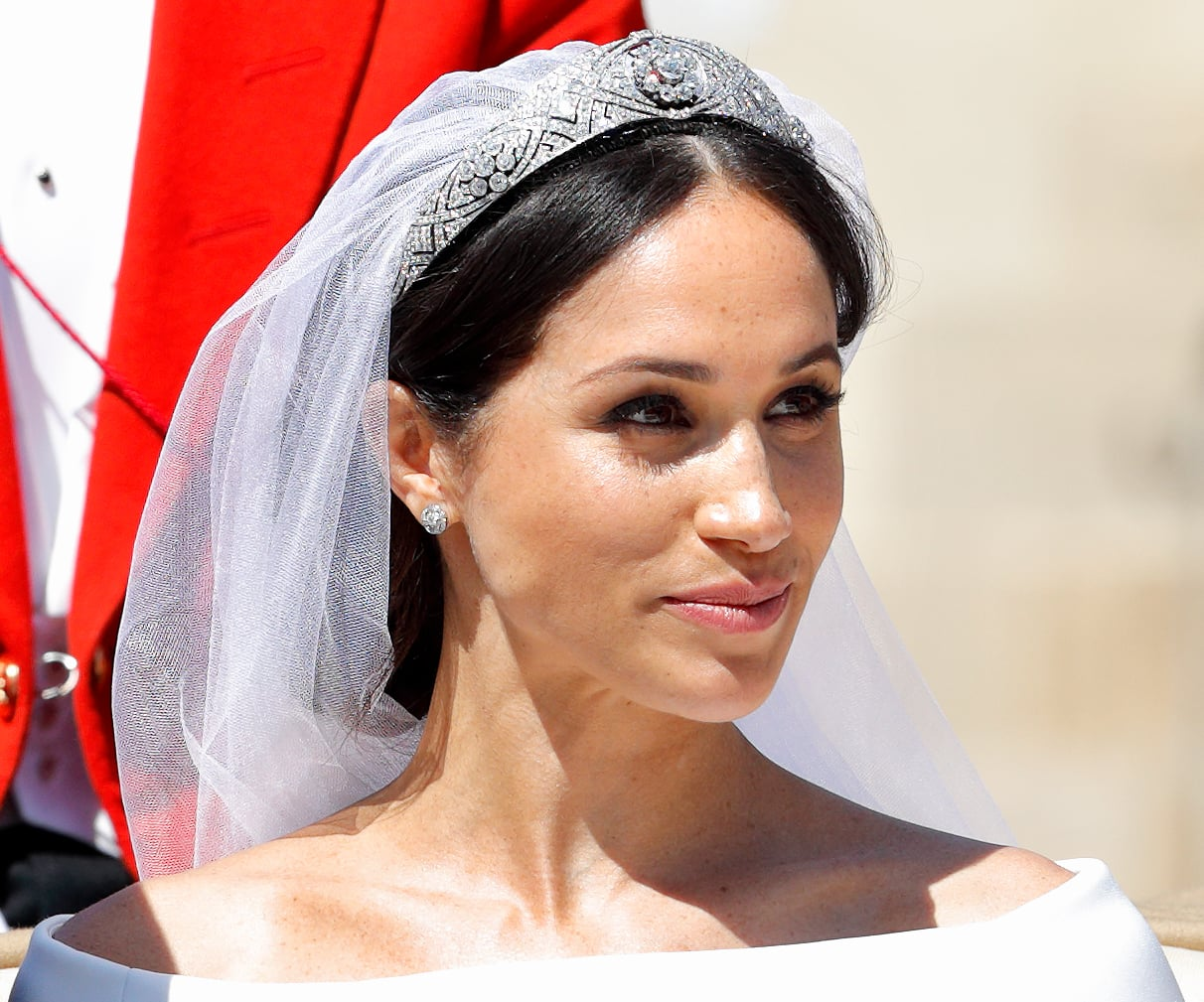WINDSOR, UNITED KINGDOM - MAY 19: (EMBARGOED FOR PUBLICATION IN UK NEWSPAPERS UNTIL 24 HOURS AFTER CREATE DATE AND TIME) Meghan, Duchess of Sussex travels in an Ascot Landau carriage as she & Prince Harry, Duke of Sussex begin their procession through Windsor following their wedding at St George's Chapel, Windsor Castle on May 19, 2018 in Windsor, England. Prince Henry Charles Albert David of Wales marries Ms. Meghan Markle in a service at St George's Chapel inside the grounds of Windsor Castle. Among the guests were 2200 members of the public, the royal family and Ms. Markle's Mother Doria Ragland. (Photo by Max Mumby/Indigo/Getty Images)
