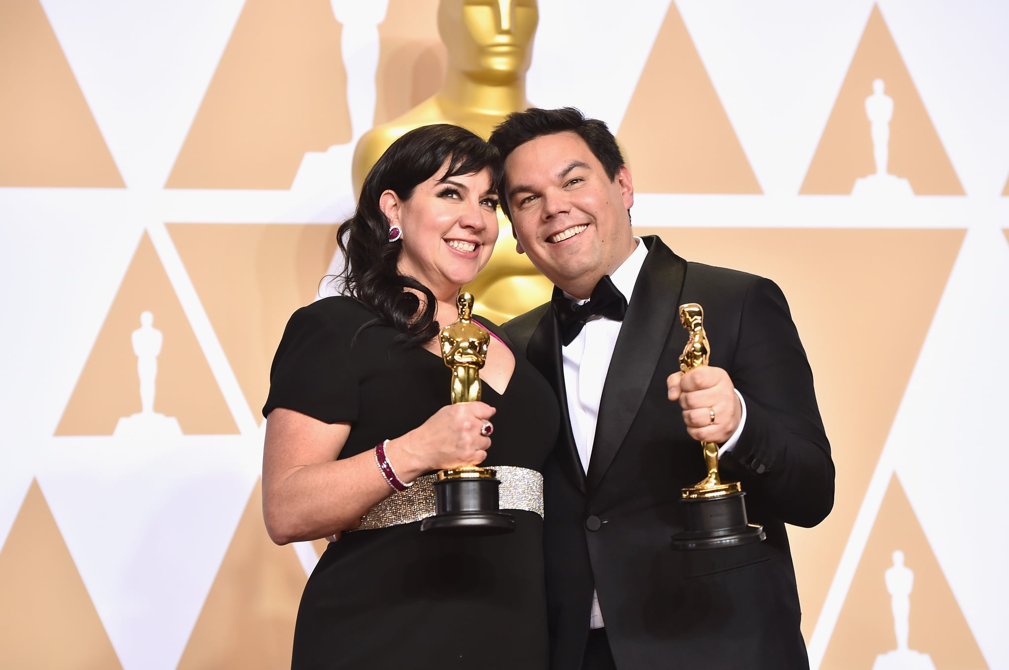 HOLLYWOOD, CA - MARCH 04:  Composers Kristen Anderson-Lopez (L) and Robert Lopez, winners of the Best Original Song award for 'Remember Me' from 'Coco,'  pose in the press room during the 90th Annual Academy Awards at Hollywood & Highland Center on March 4, 2018 in Hollywood, California.  (Photo by Alberto E. Rodriguez/Getty Images)