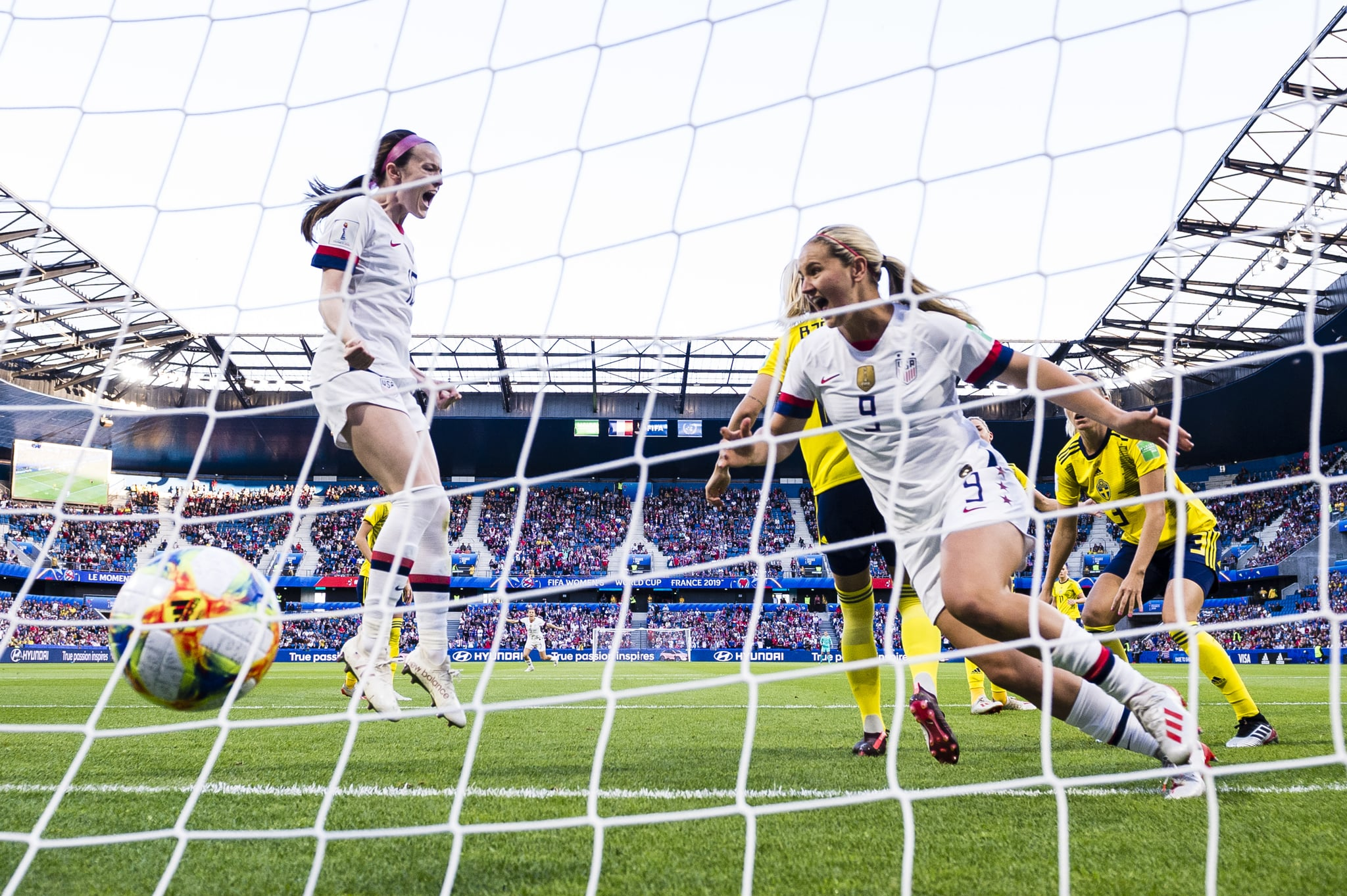 LE HAVRE, FRANCE - JUNE 20: Lindsey Horan of United States (R) celebrating the opening goal of USA during the 2019 FIFA Women's World Cup France group F match between Sweden and USA at  on June 20, 2019 in Le Havre, France. (Photo by Marcio Machado/Getty Images)