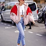 With White Boots, a Crop Top, and a Puffer Jacket