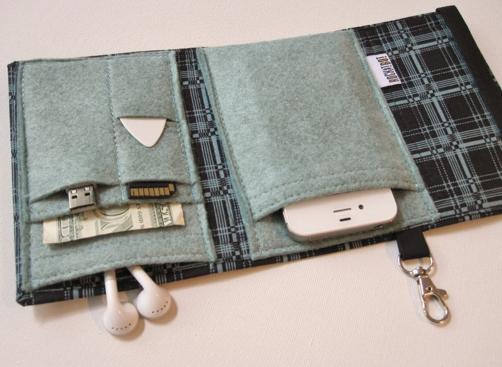 Transferring all your necessary gizmos from one bag to another (and in and out of your desk) can be a real hassle. The Nerd Herder Gadget Wallet ($29) adds some pizzazz with pixelated plaid while securing your cell phone, USB drive, SD card, office key card, earbuds, and more.