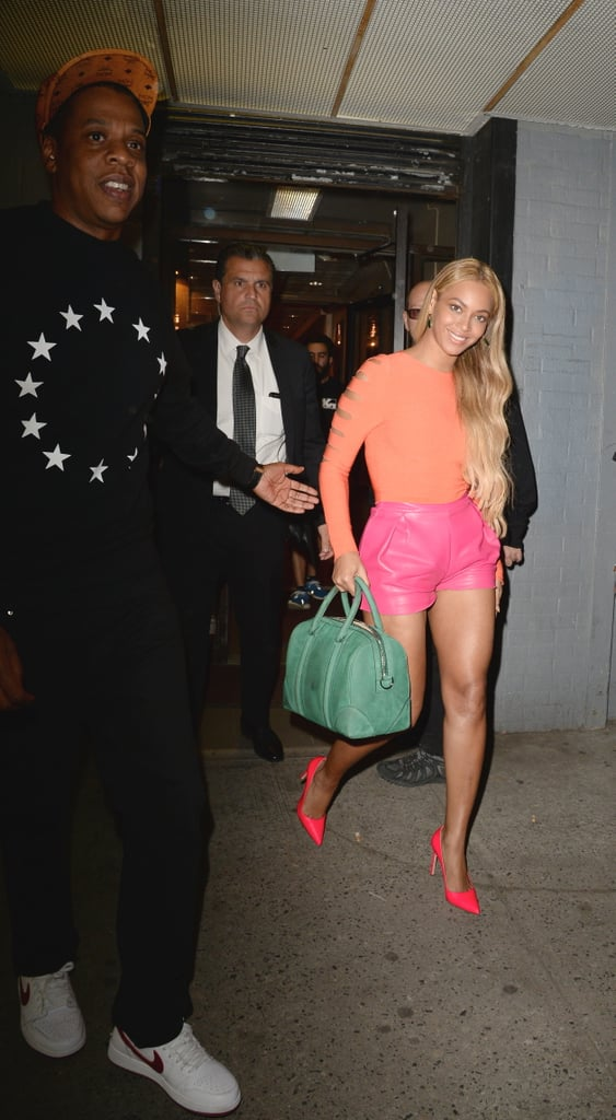 Beyoncé brought the wow factor in sherbet-colored separates, while Jay Z played it cool in black and white.