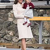 Kate boarded her flight back to London in a Catherine Walker tailored coat, pinned with the queen's maple brooch. She wore neutral L.K.Bennett pumps to complete the sophisticated look.