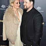 """On why their relationship works: """"We just get each other. We're both laid-back people. It's never been a job to be in this relationship.""""  On Nicole's past: """"She made some mistakes, but look at where we're from: I'm in a rock and roll band. Nicole is who she is.""""   On how many times he asked Nicole to marry him: """"People don't know this, but I asked her to marry me 10 times before she actually said yes. I was asking every other Tuesday.""""     On how he asked for her hand in marriage: """"I hinted around at it and she's not one to beg anyone for anything, so every time I'd kind of hint she was always so nonchalant like she was cool. She doesn't want any handouts, so I was always so confused. I was waiting for her to say, 'When are you going to ask?' and that's not the kind of woman she is. She keeps you on your toes for sure.""""   On when Joel finally proprosed to Nicole: """"It was a Tuesday. I just woke up one morning and said, 'You know, we have two kids already,' and I was just like, 'What am I doing? I'm a fool. Why haven't I asked her to marry me?' and did it that night."""""""