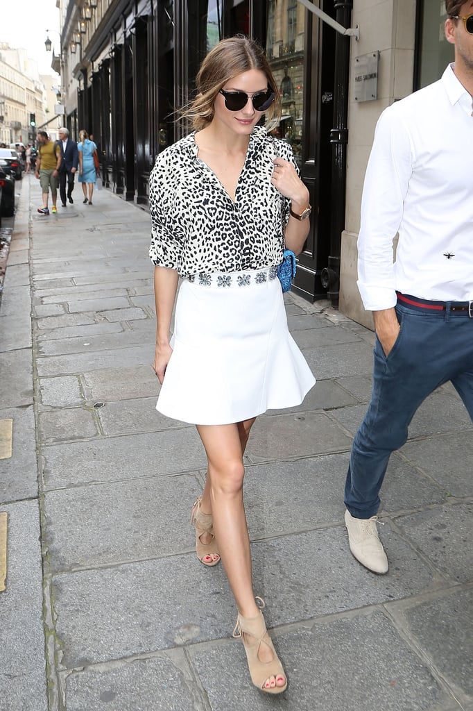 Olivia took a walk on the wild side in her animal-print top, which she smartly paired with a fit-and-flare skirt embellished around the waist.