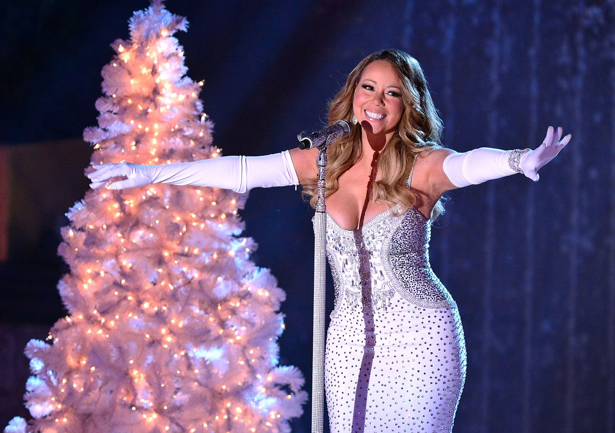 Mariah Carey Sparkles in Sexy Dress by the Christmas Tree