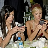 Kim Kardashian and her BFF Paris Hilton were all texts, no talk at the LA premiere of Entourage in June 2006.