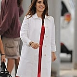 Penelope Cruz kept up her smile as the day of shooting continued.