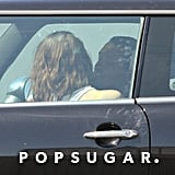 Rupert Sanders and Kristen Stewart cuddled up in her car.