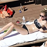 Brooklyn Decker got some sun in her bikini by the pool in Australia.