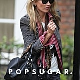 Kate moss wore a black denim jacket and a red striped oxford while out in London.