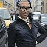 From the head scarf and the pearl bauble earrings to the cat-eye sunglasses, this fashionista is retro glam.