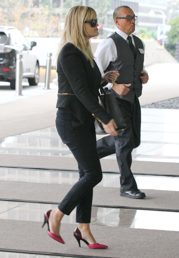 Reese Witherspoon brought a pop of pink to her all-black look.