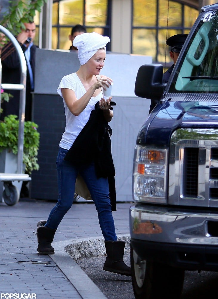 Kate Hudson hopped into a van with a towel covering her wet hair in Boston.