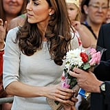 Kate accepts flowers.