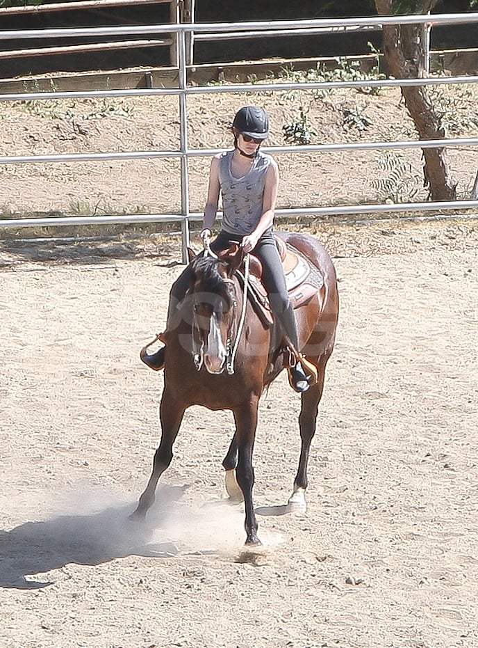 Kristen Stewart mounted a horse in Palm Springs Friday. She was decked out in her usual tee and jeans outfit but also sported a helmet and riding boots. It appears the actress is prepping for her role in Snow White and the Huntsman, which will have the star atop a horse for filming. Kristen's been staying in shape with regular workout sessions all week, and she was most recently spotted leaving a yoga class in LA on Thursday. The equestrian fun ended since Kristen was back in Beverly Hills Saturday, and she threw on cutoff shorts to take care of some errands. Kristen was greeted with a parking ticket, though, when she arrived back at her Mini Cooper.