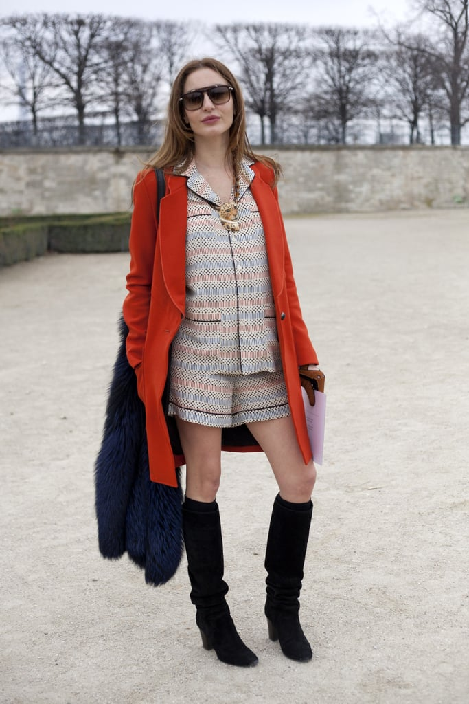 Pajama dressing gets a luxe finish with a colored fur and knee-high boots.