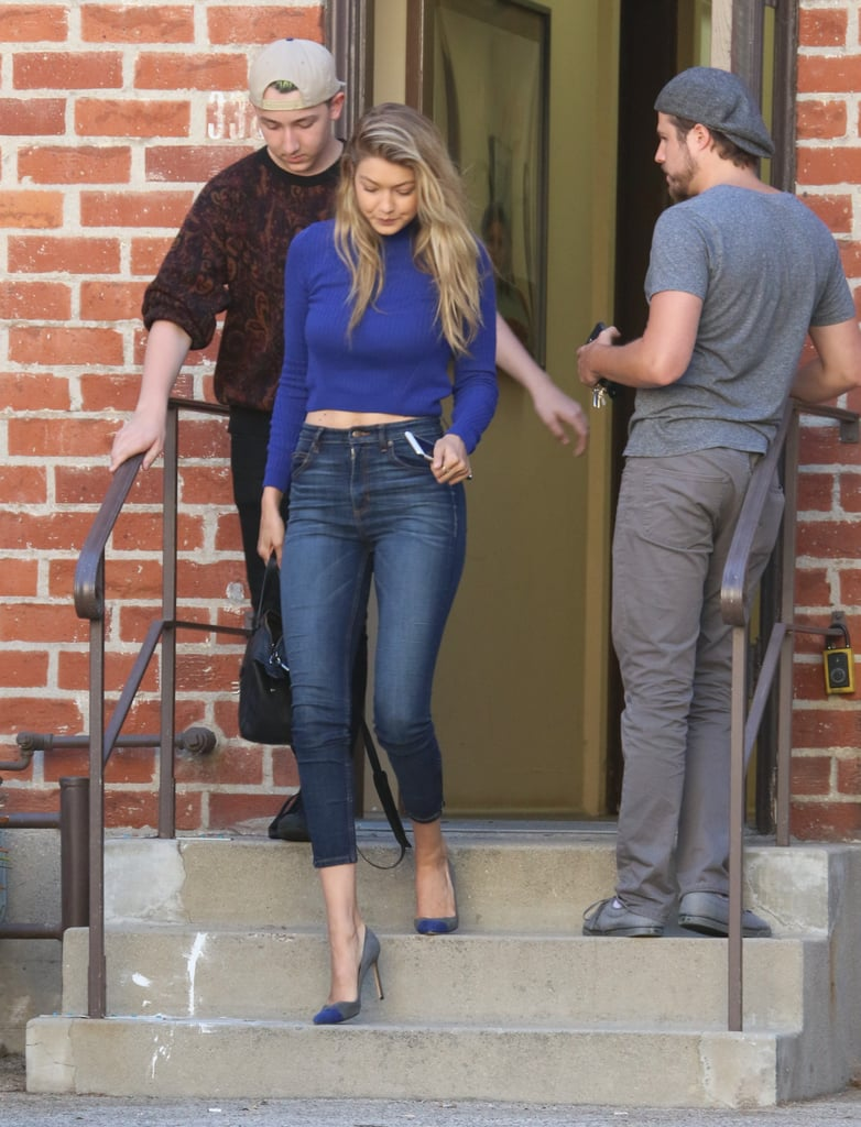 Wearing Guess skinnies with a blue crop top and heels.