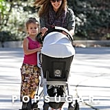 Jessica Alba smiled while her daughter Honor Warren, hitched a ride on younger sister Haven's stroller in March 2012.
