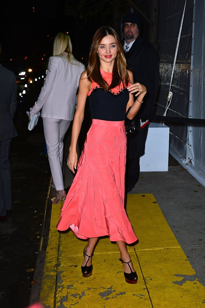 Miranda Kerr's coral pink midi skirt coordinated perfectly with her black-and-coral top. She finished with T-strap sandals and a few delicate jewels. Find a similar pink skirt to twirl the night away in.