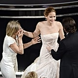Jennifer Lawrence reacted to her big win at the Oscars with her mom and Bradley Cooper.