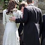 William rested his hand on Kate Middleton's back at a wedding in June.