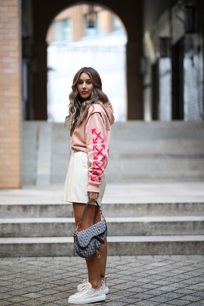 Continue wearing your hoodie into the warmer months with the addition of a cute miniskirt.