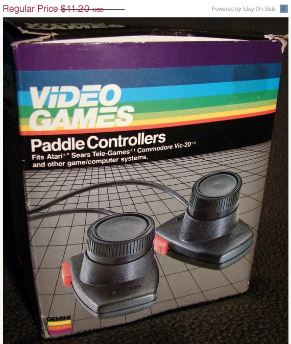 "You know your technology has jumped to the '80s when the font gets ""futuristic"" and the product is photoshopped to look like it's in another dimension, as seen with the Atari Paddle Controllers. Source: Etsy user TimeEnoughAtLast"
